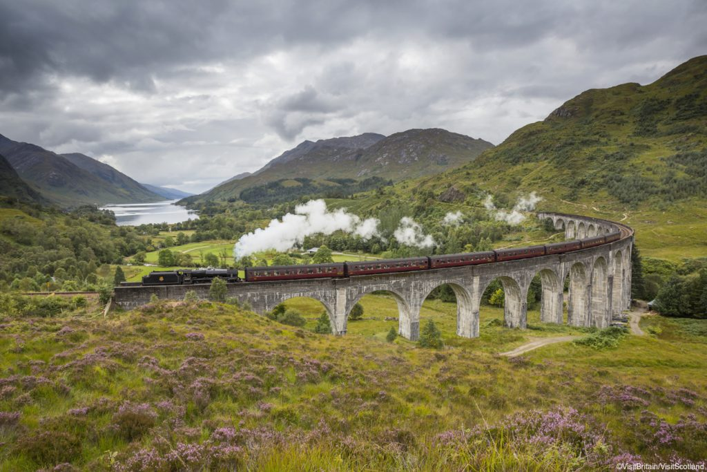 Scotland Group Tours - Jacobite steam train passing over the Glenfinnan Viaduct